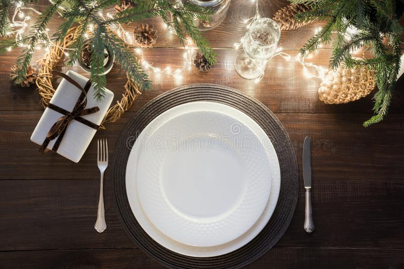 Christmas table setting with silverware, garland and dark decor. Top view. Xmas Party. Magic night. Christmas table setting with silverware, garland and dark royalty free stock photography