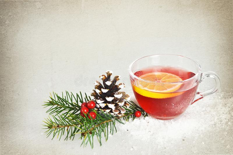 Christmas tea in transparent cup on grunge background royalty free stock photo