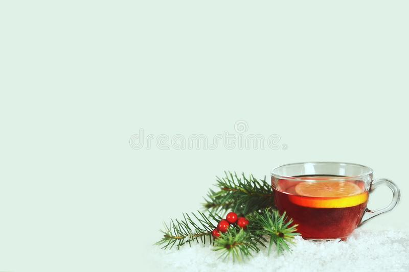 Christmas tea in transparent cup on light background with copy space stock image