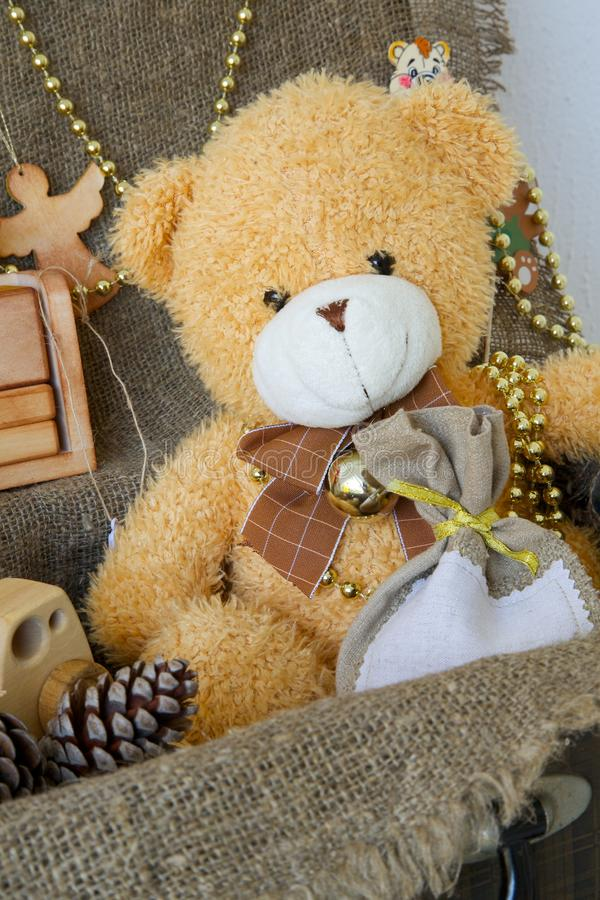 Christmas teddy bear. In an old case with decorative items for a festive season stock images