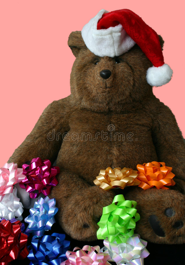 Christmas Teddy Bear Wearing Santa's Hat with Pink Background royalty free stock photos