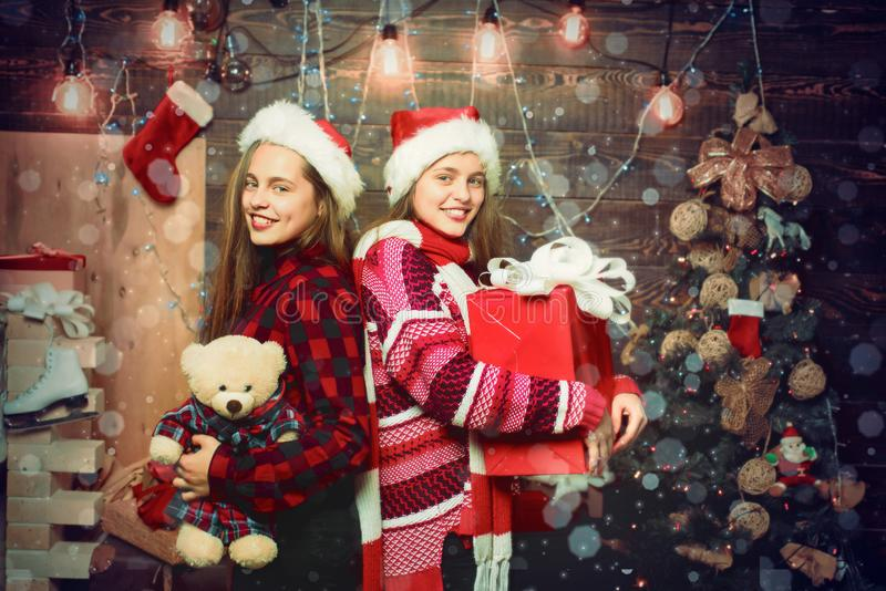 Christmas teenagers. Little girl with a Christmas present on wooden background. Winter kids. Kid enjoy the holiday. Christmas card. New year kids. Happy Little stock photos