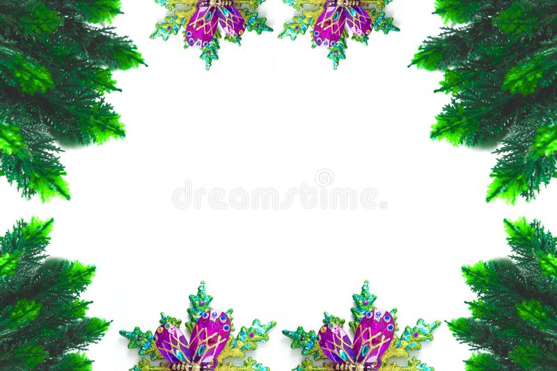 Christmas theme frame or border in white background. Decoration, ornament, pine, cypress, green, december royalty free stock photo
