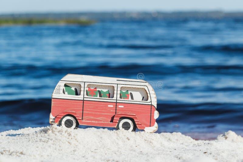 Christmas theme with a van on a white sandy beach on Lake Louisa in Clermont Florida. Christmas in Florida concept featuring a van on a white sandy beach on Lake royalty free stock photos