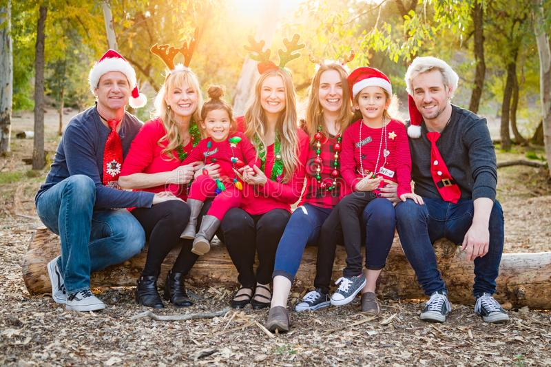 Christmas Themed Multiethnic Family Portrait Outdoors. Fun Christmas Themed Multiethnic Family Portrait Outdoors royalty free stock images