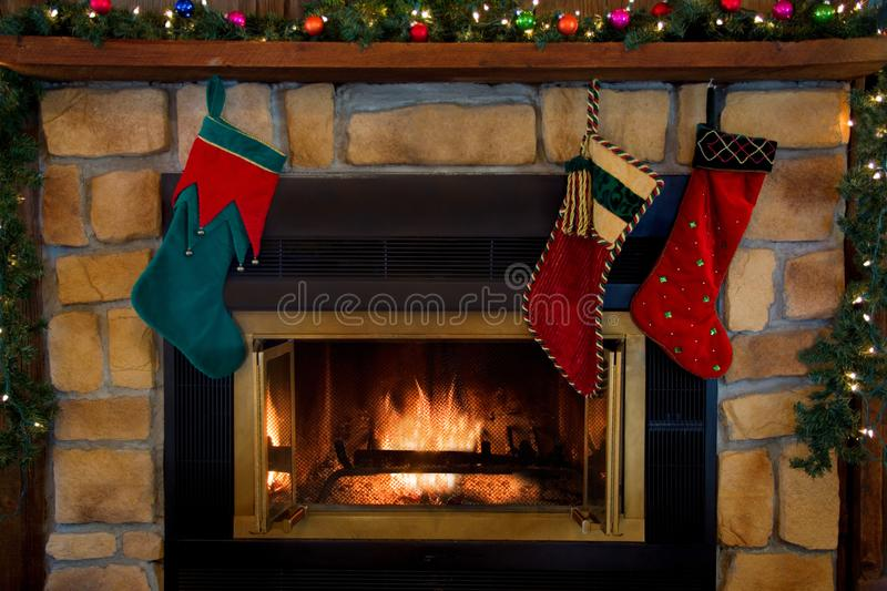 Christmas Three Stockings Hanging Over Fireplace royalty free stock photography
