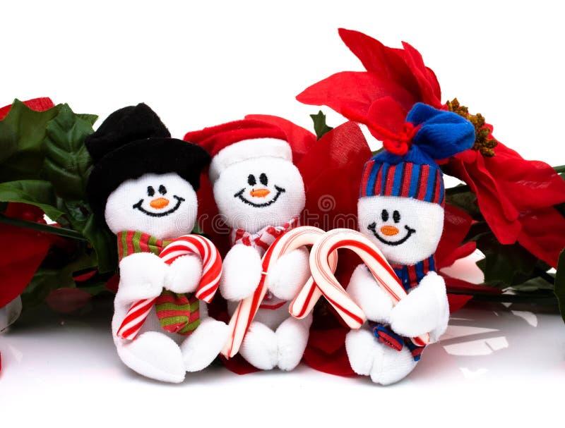 Christmas Time. Poinsettia border with three snowmen on a white background, Christmas Time stock photography