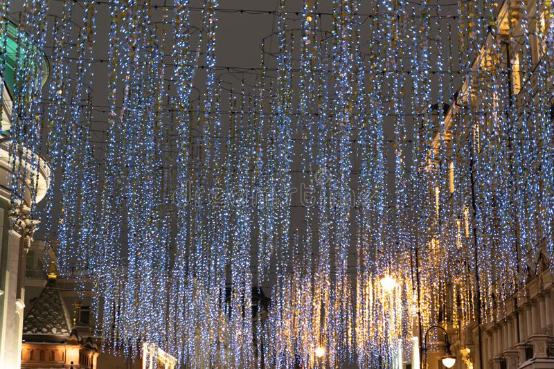 Christmas time city decoration. Lights and toys on the city street during winter holiday season. Festive illuminations in the royalty free stock images