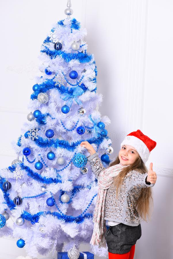 Christmas time decor. Girl with happy face on white background. stock photos