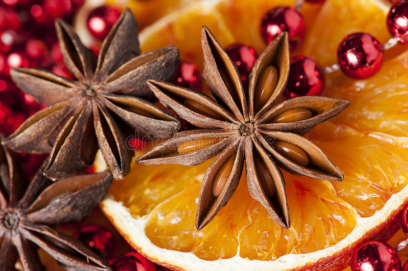 Christmas time. Christmas decoration - anise stars, orange slices and baubles in red stock photos