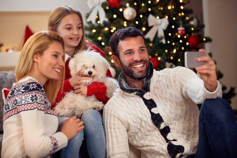 Christmas time family self-portrait- smiling family. Christmas time family self-portrait- young smiling family royalty free stock photo