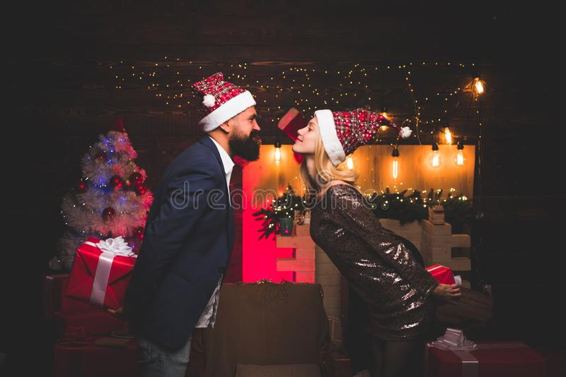 Christmas time for kissing. Merry Christmas and Happy New Year. Christmas couple in love. Sexy Women of Hot Celebrities. stock photo