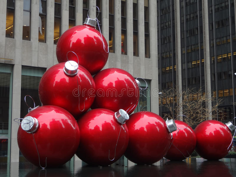 Christmas Time in New York City. Larger than life red Christmas Tree Bulbs line the sidewalk of downtown New York City royalty free stock image