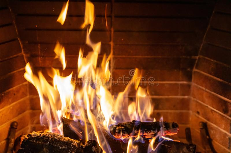 Christmas time. Wood burning in a cozy fireplace at home royalty free stock photos