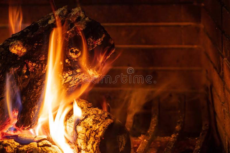 Christmas time. Wood burning in a cozy fireplace at home stock photography