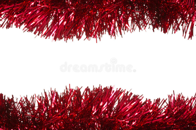Christmas tinsel as a border. Isolated on white background royalty free stock photos