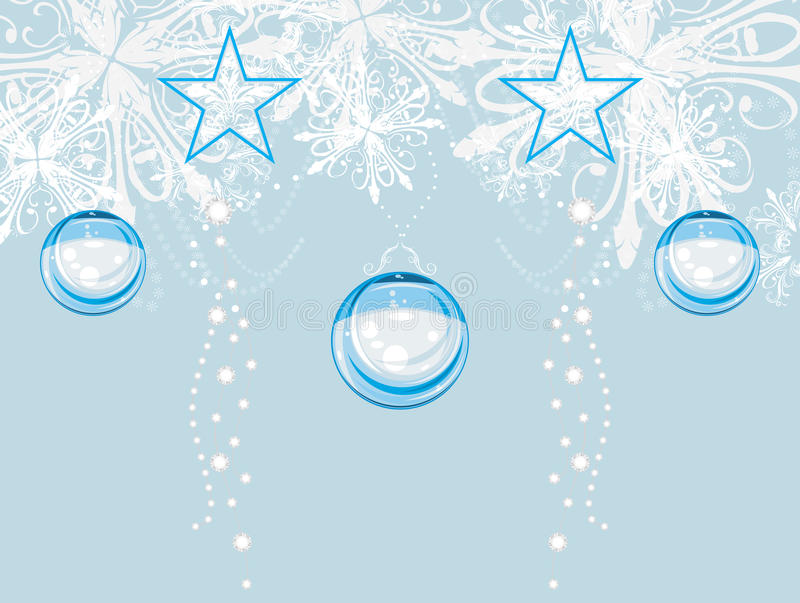 Christmas tinsel on the light blue background royalty free stock photography