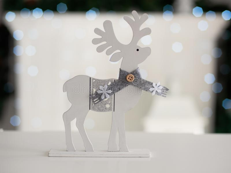 Christmas toy deer on the background of Christmas background with bokeh. Christmas toy deer on the background of Christmas background with bokeh royalty free stock image