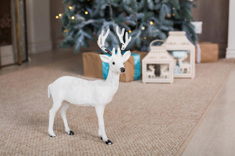 Christmas toy deer. Under fir-tree royalty free stock photography