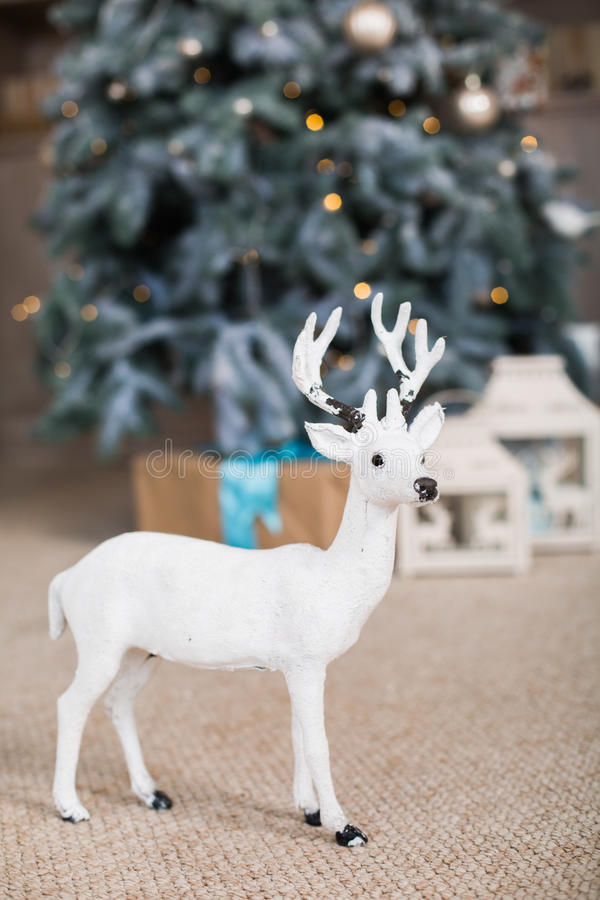 Christmas toy deer. Under fir-tree stock photography