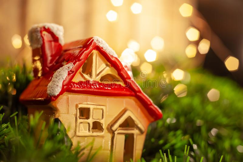 The Christmas toy a figure a lodge with a red roof royalty free stock photos