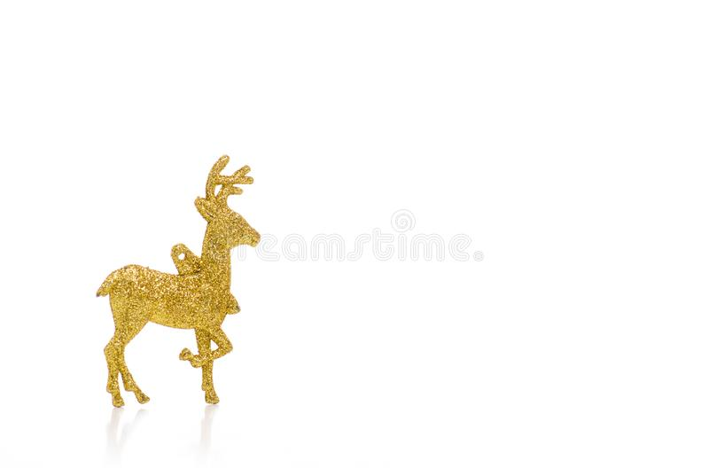 Christmas toy gold deer. On a white background. Isolation royalty free stock image