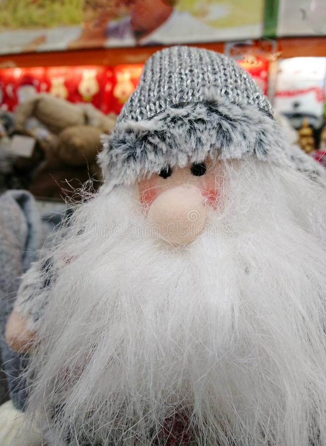 Christmas toy grandfather with a beard. Christmas toy grandfather with a white beard in a hat stock image