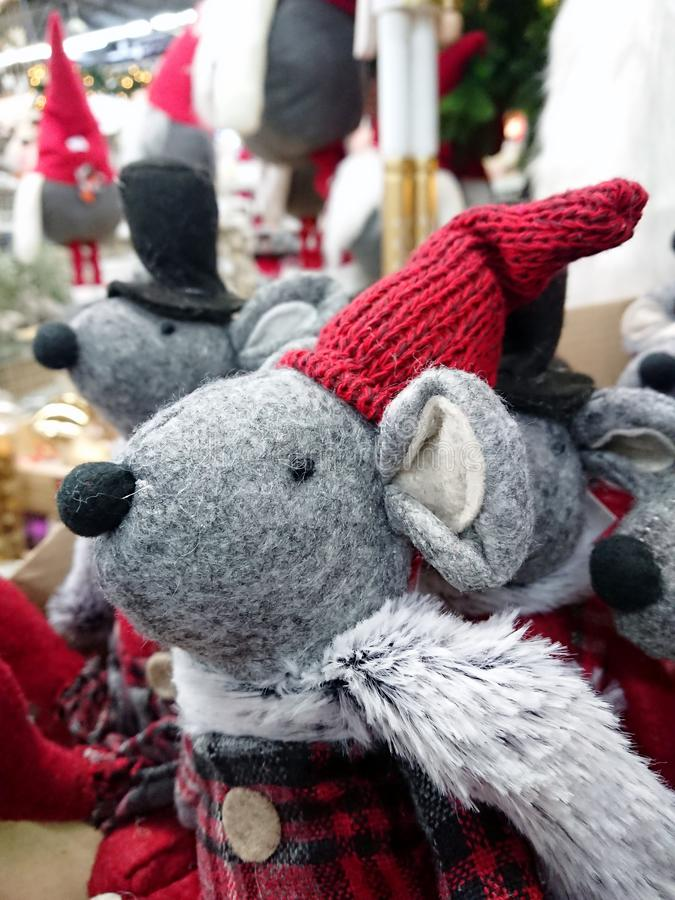 Christmas toy gray rat in a hat. Christmas toy gray rat in a red cap and a red draped coat stock photography