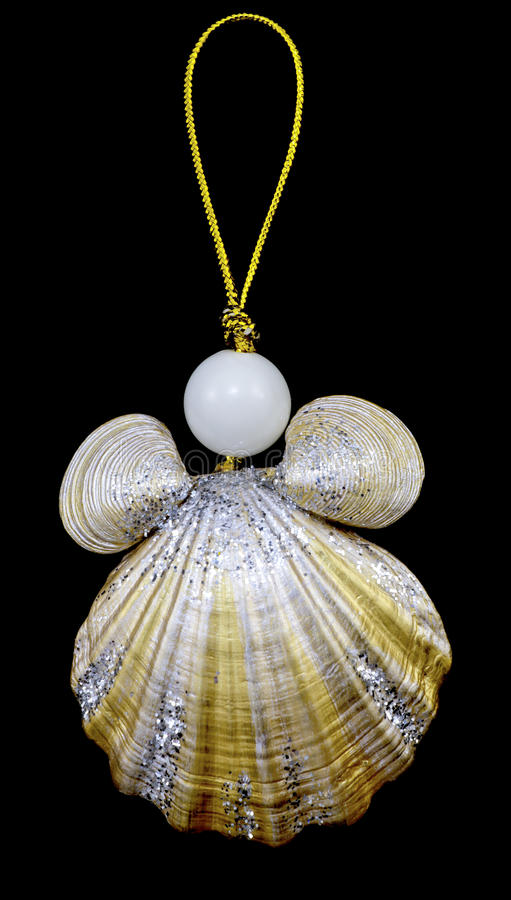 Christmas toy key chain from seashells and pearls with gold rope isolated stock image