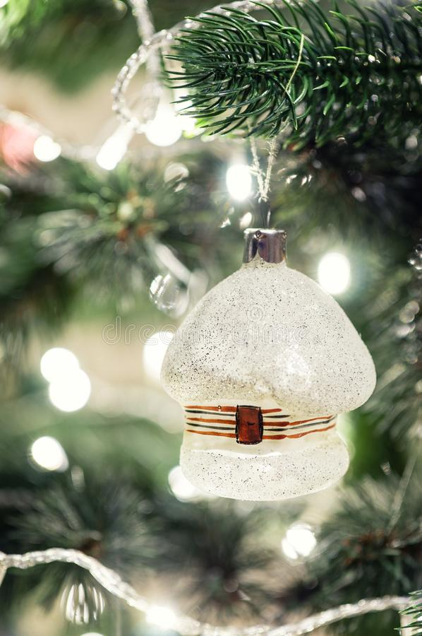 Christmas toy in the shape of a house hanging on the tree. Christmas toy in the shape of a house hanging on the Christmas tree stock images