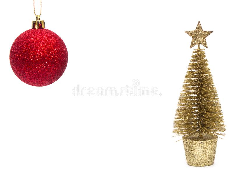 Christmas toy, a shiny red ball and a golden tree. New Year. Isolated on white background royalty free stock photo