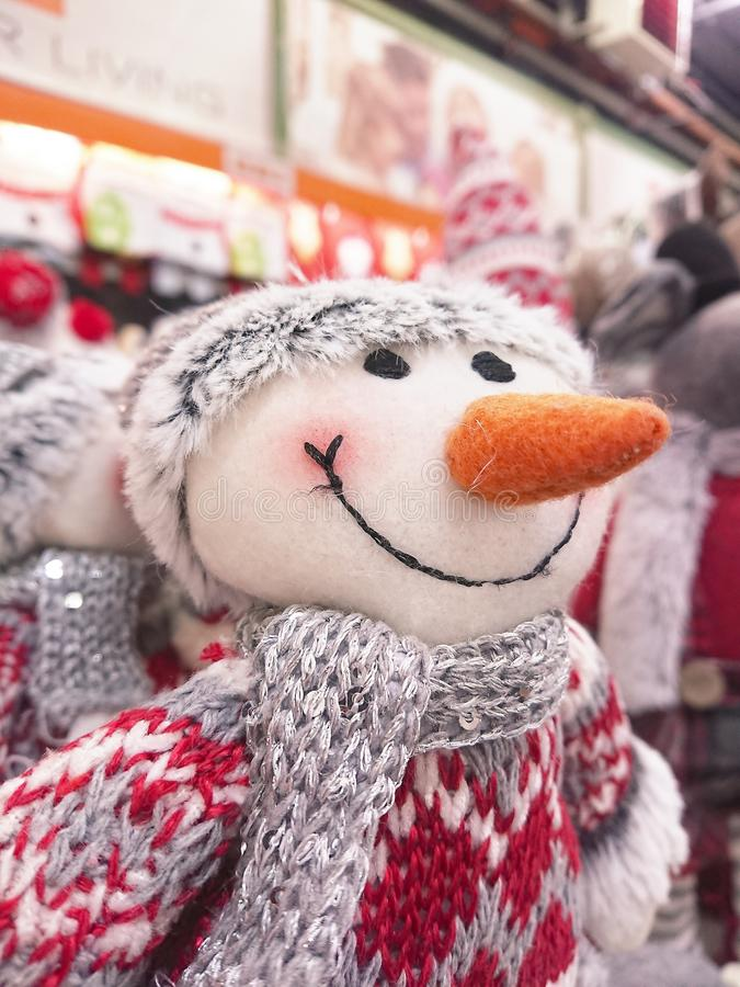 Christmas toy snowman with red nose. Christmas toy snowman with a red nose in a knitted scarf and hatn stock images