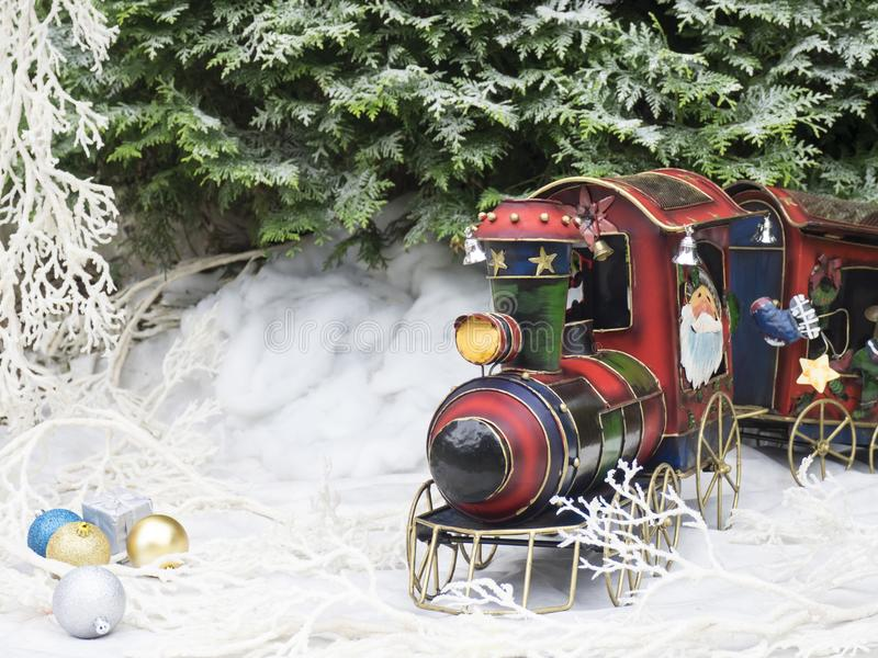 Christmas toy steam train in the winter forest. royalty free stock photography