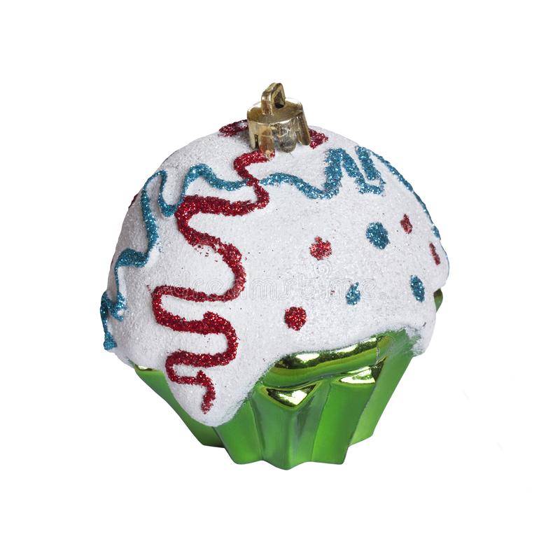 Christmas toy on white background isolated. Festive artificial Green cupcake stock images