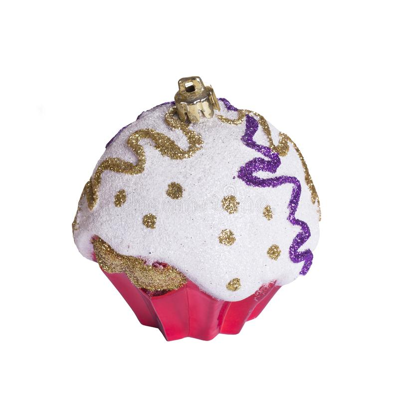 Christmas toy on white background isolated. Festive artificial pink cupcake stock photo