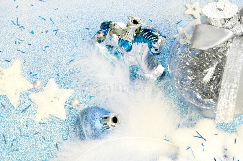 Christmas toys blue and white. Snowflakes, stars, horse and balloons on a snow background. royalty free stock images