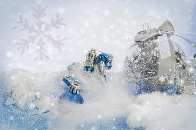 Christmas toys on a blue and white snowy background. royalty free stock images