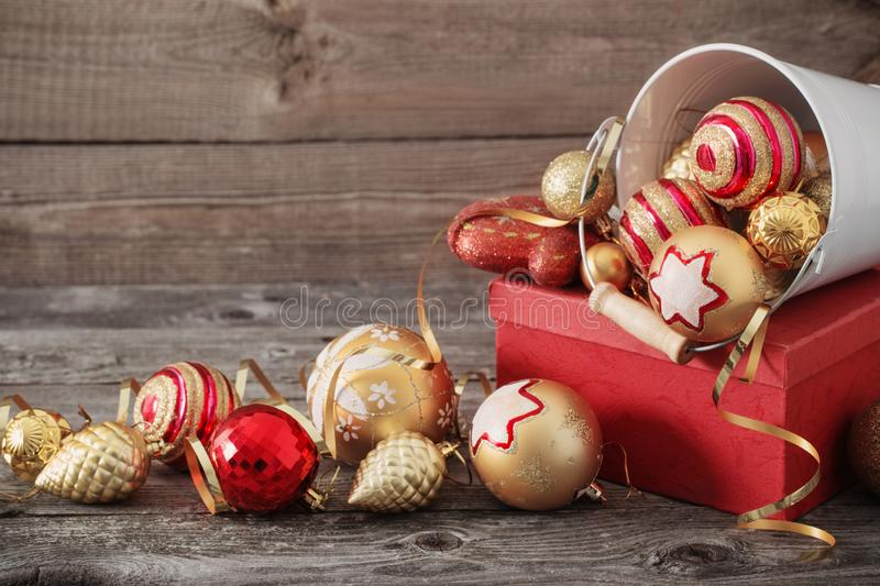 Christmas toys and box on old wooden background royalty free stock photos