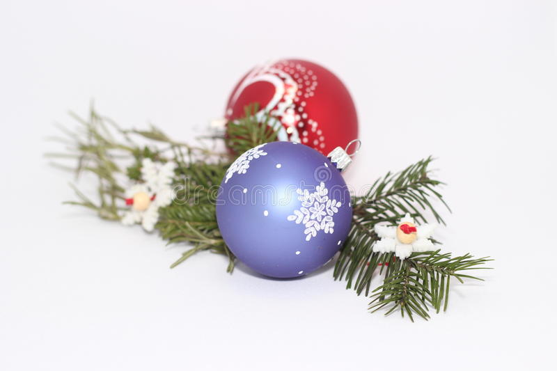 Christmas toys with a sprig of fir tree royalty free stock photo