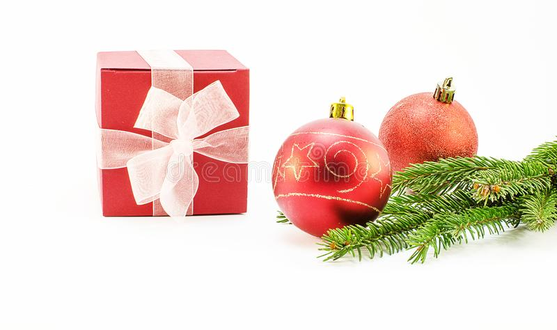 Christmas toys and Christmas tree branch stock images