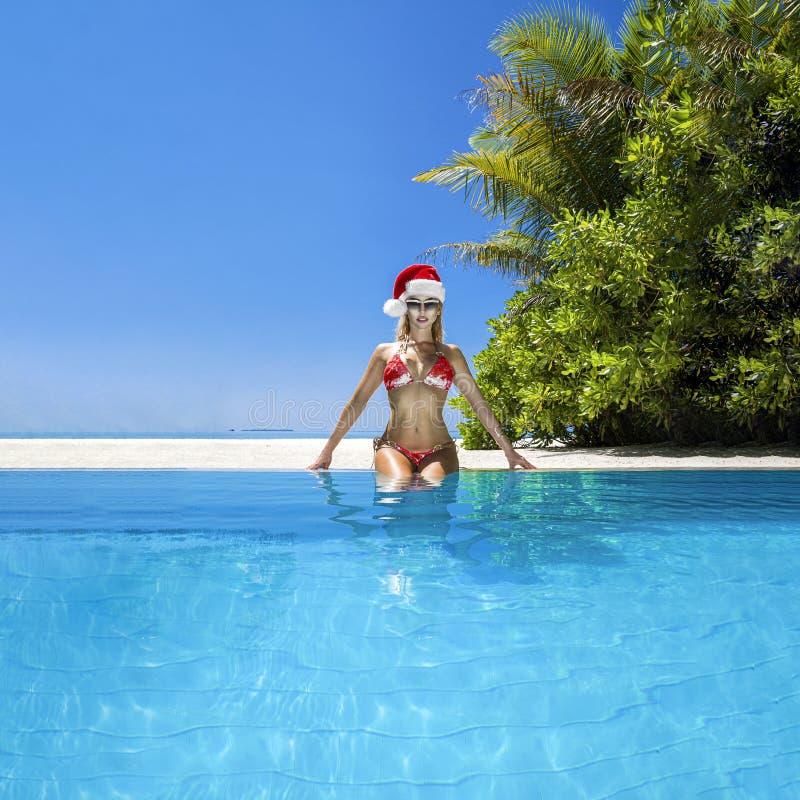 Christmas travel beach holidays in Maldives. Christmas Maldives beach and Santa Claus woman. Bikini girl wearing santa hat stock photography