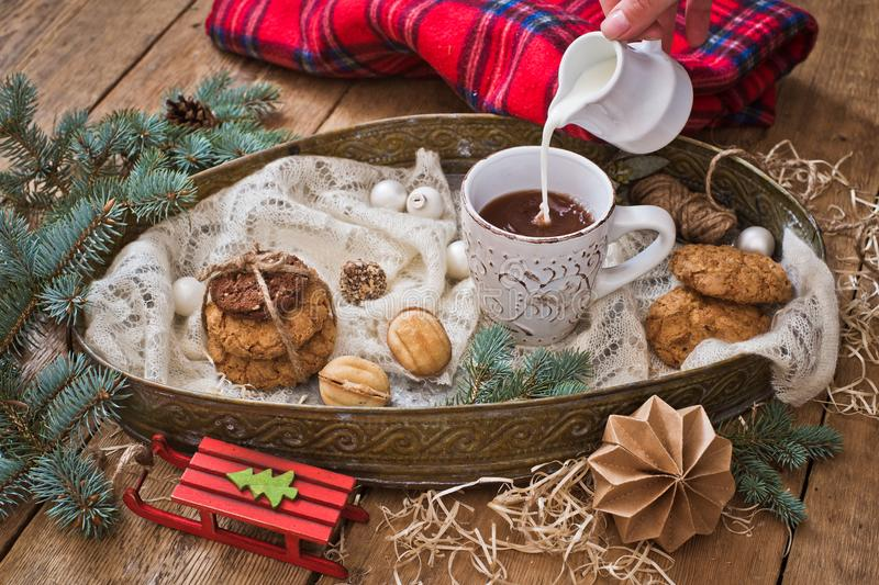 Christmas treats and decor. Milk pouring into a mug stock images