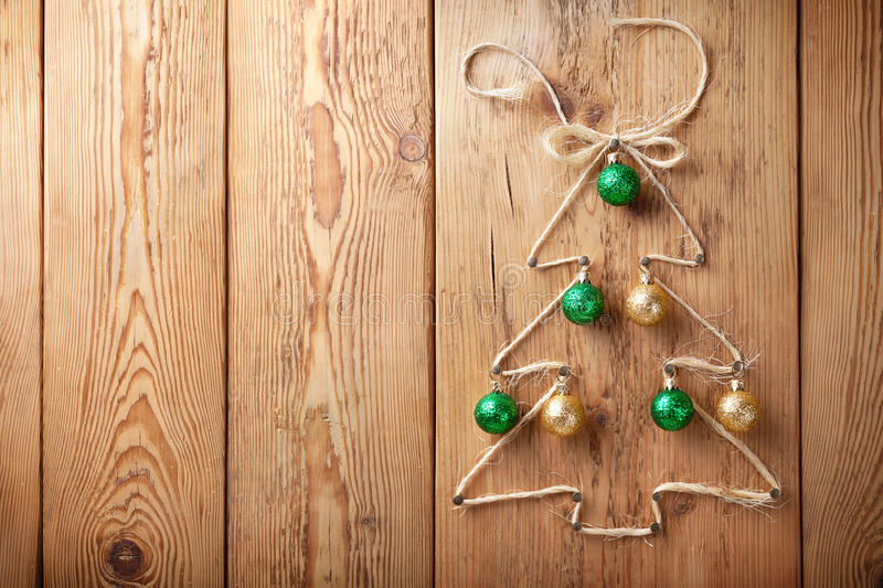 Christmas Tree. With balls on wooden background with copy space stock images