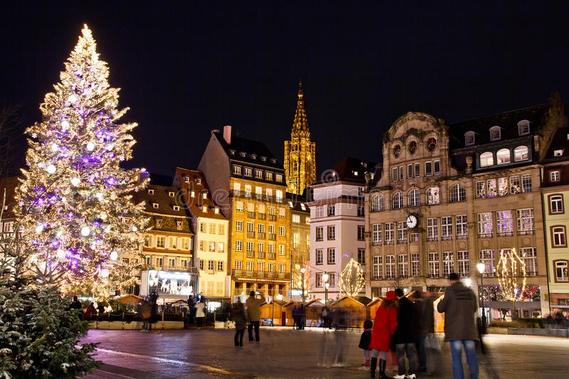 Christmas Tree. At the Kleber Place of Strasbourg illuminated with the Cathedral as background, France