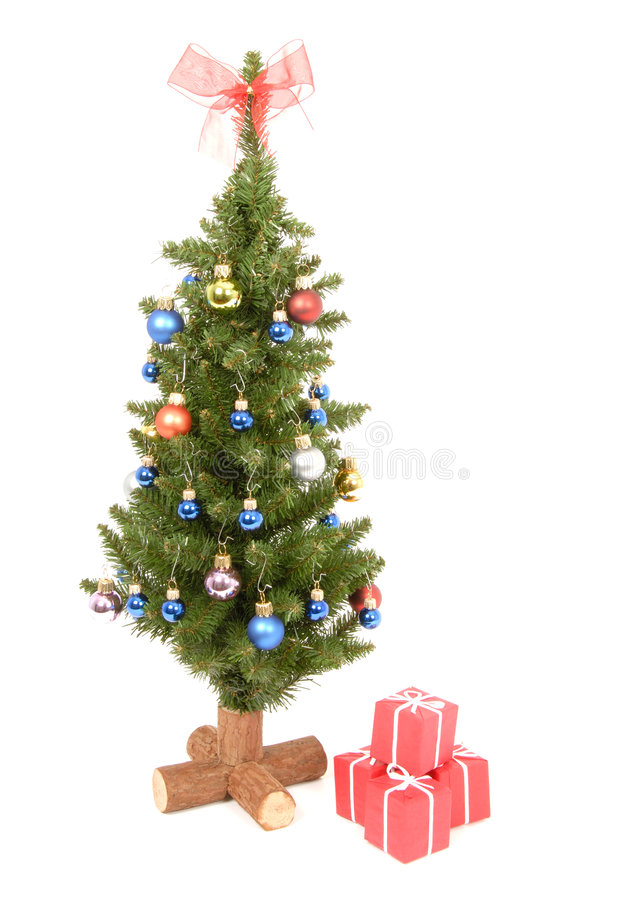 Christmas Tree. A small Christmas Tree decorated with colorful balls, isolated on white royalty free stock photos