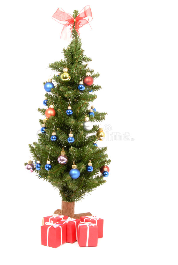 Christmas Tree. A small Christmas Tree decorated with colorful balls, isolated on white stock images