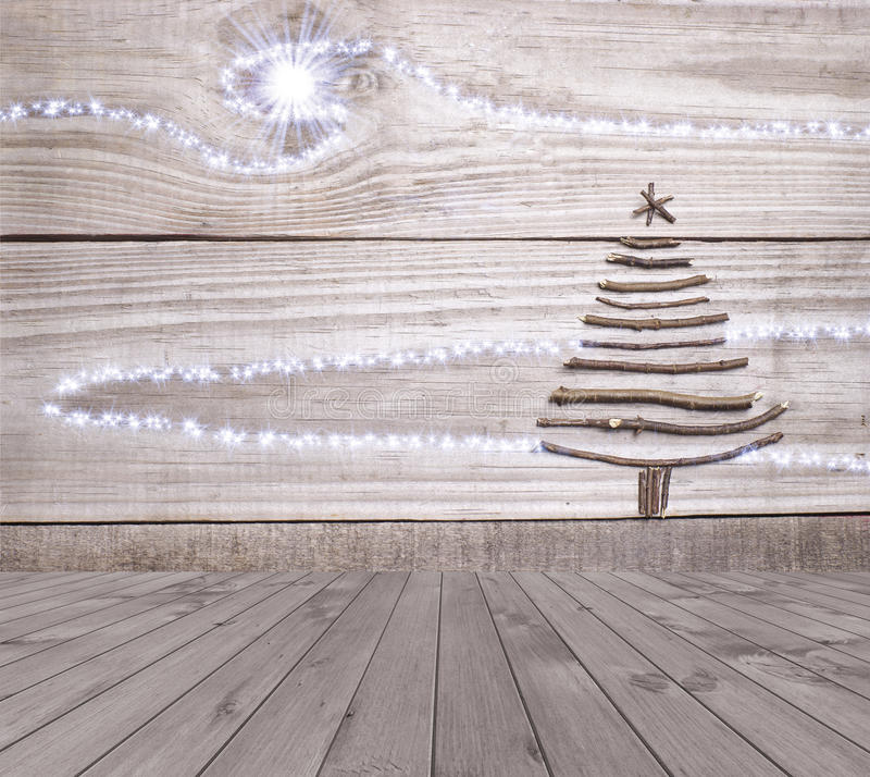 Christmas tree arranged from sticks on empty wooden deck table on sparkly grey background. Ready for product display montage.  stock photography