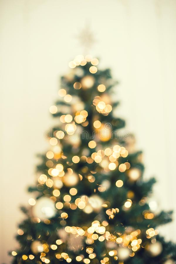 Christmas tree background with blurred, sparking, glowing. Happy New Year and Xmas theme royalty free stock photo