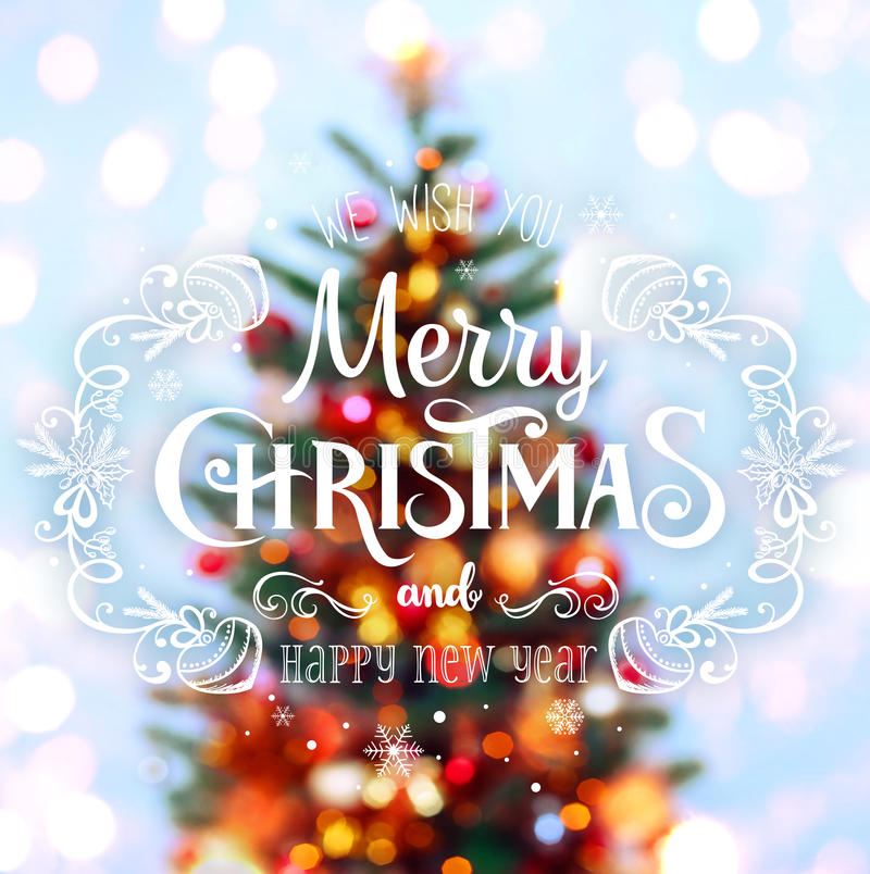 Christmas tree background and Christmas decorations with blurred, sparking, glowing and text Merry Christmas and Happy New Year. Xmas theme royalty free stock images