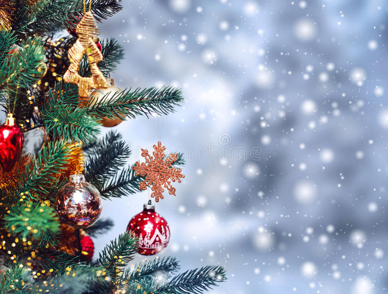 Christmas tree background and Christmas decorations with snow, blurred, sparking, glowing. Happy New Year and Xmas. Theme stock photo